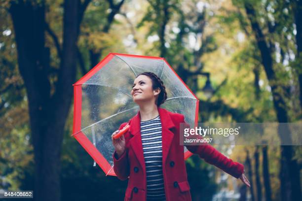 Beautiful young woman enjoying a rainy day