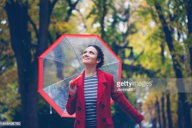 Beautiful young woman enjoying a rainy day
