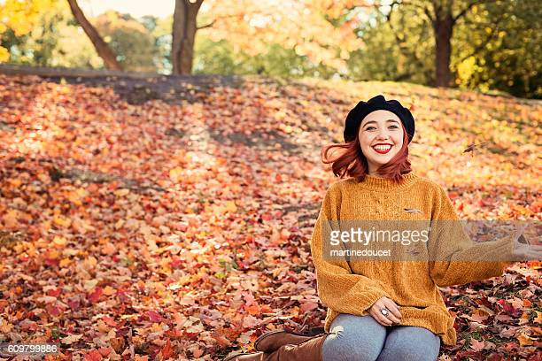 "beautiful young woman enjoying autumn season in nature. - ""martine doucet"" or martinedoucet stock-fotos und bilder"