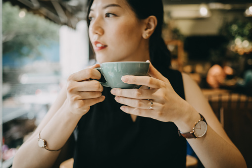 Beautiful young woman enjoying coffee in cafe - gettyimageskorea