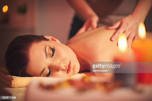 beautiful young woman enjoying massage - sensual massage stock photos and pictures