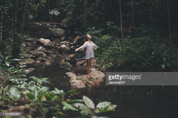 beautiful young woman enjoys in nature - gratitude stock pictures, royalty-free photos & images