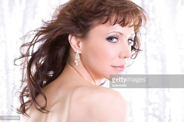 beautiful young woman fashion model over shoulder in diamond earrings - skin diamond stock pictures, royalty-free photos & images
