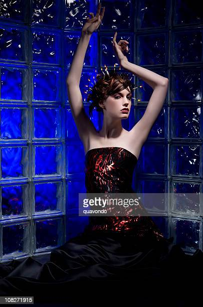 Beautiful Young Woman Fashion Model with Fire Hair, Glass Wall