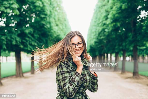 Beautiful young woman having fun in park