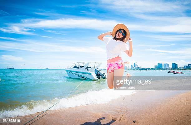 Beautiful young woman having fun on beach