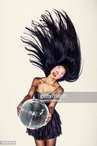 beautiful young woman holding disco ball - black women wearing pantyhose stock pictures, royalty-free photos & images