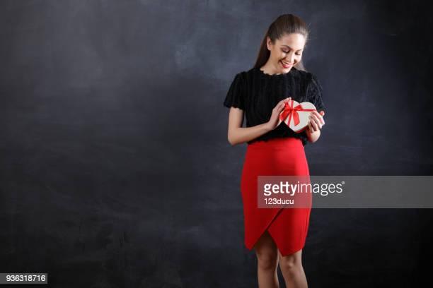 Beautiful Young Woman Holding Gift Box