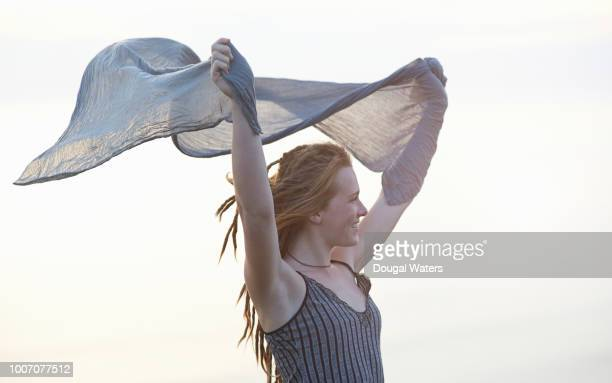 beautiful young woman holding shawl in wind. - ストール ストックフォトと画像