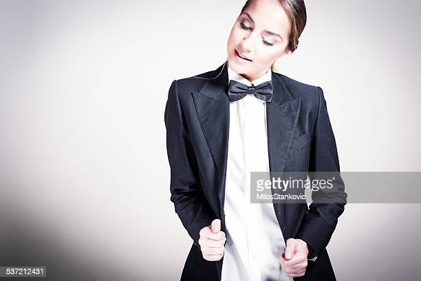 beautiful young woman in a man's suit - bow tie stock pictures, royalty-free photos & images