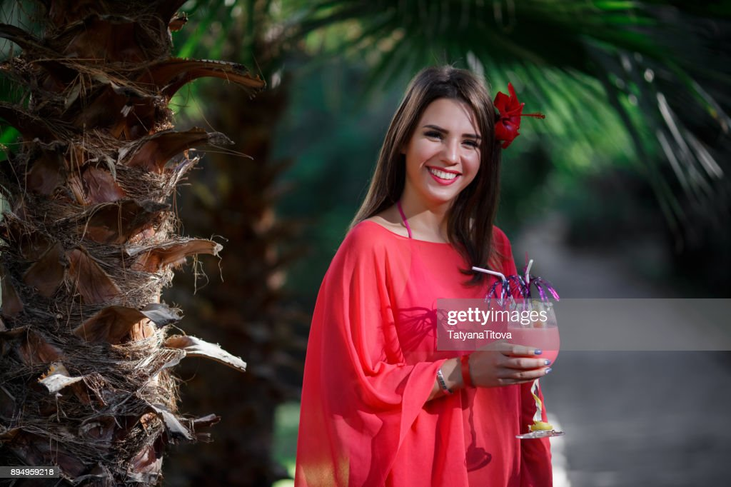 Beautiful Young Woman In Bikini And Red Hibiscus Flower In Long Hair