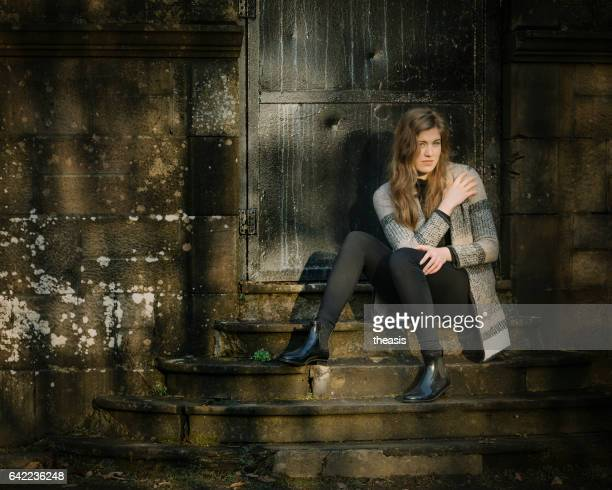 beautiful young woman in black and grey - theasis stock pictures, royalty-free photos & images