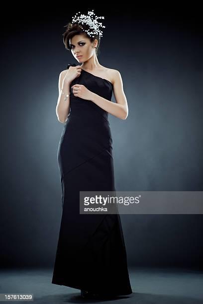 Beautiful Young Woman in Black dress Studio portrait