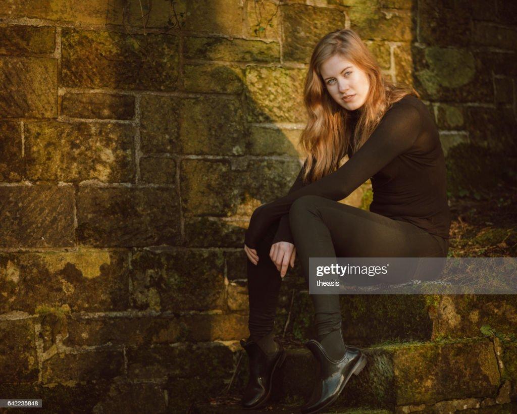 Beautiful young woman in black : Stock Photo