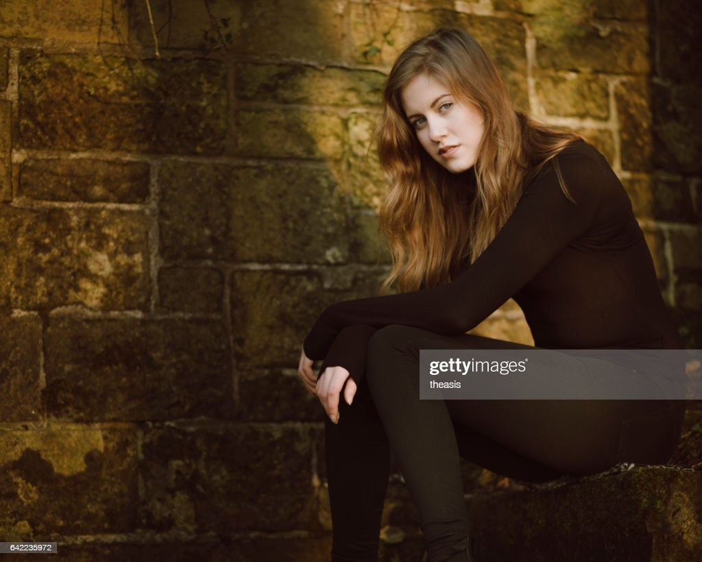 Beautiful young woman in black : Stock Photo
