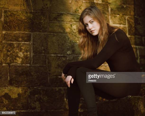 beautiful young woman in black - theasis stock pictures, royalty-free photos & images
