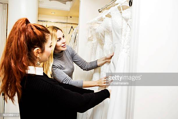 beautiful young woman in bridal boutique - moment collection stock pictures, royalty-free photos & images
