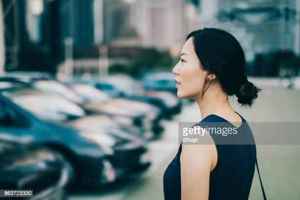 Beautiful young woman in downtown financial district in Hong Kong