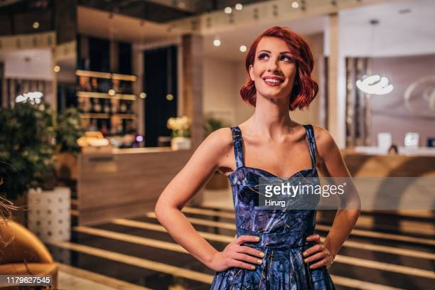 beautiful young woman in elegant dress - dyed red hair stock pictures, royalty-free photos & images