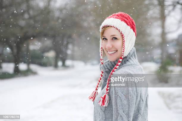Beautiful Young Woman in Knit Cap on Snowy Day, Copyspace