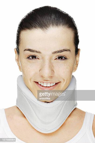 Beautiful Young Woman in neck corset smiling on white background