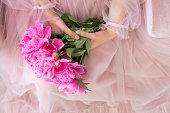 beautiful young woman pink dress holding