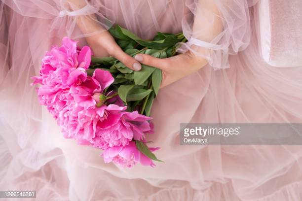 beautiful young woman pink dress holding