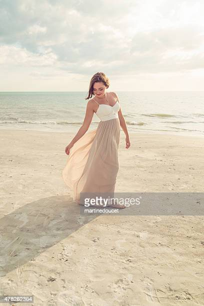 "beautiful young woman in prom dress on the beach. - ""martine doucet"" or martinedoucet stock pictures, royalty-free photos & images"