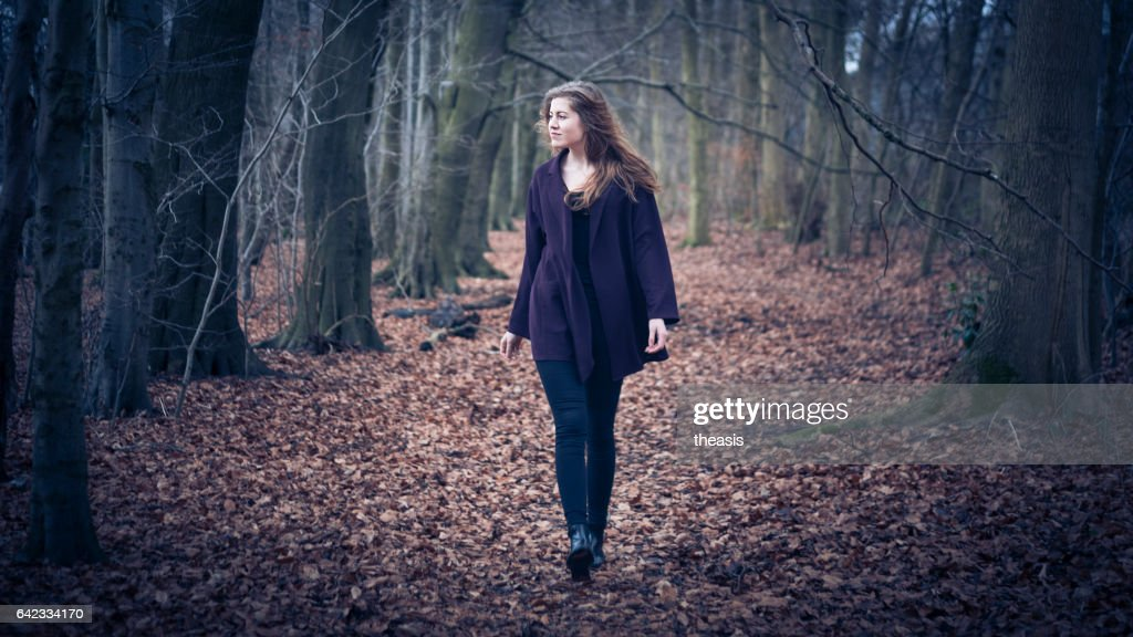 Beautiful young woman in the woods : Stock Photo
