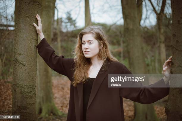 beautiful young woman in the woods - theasis stock pictures, royalty-free photos & images