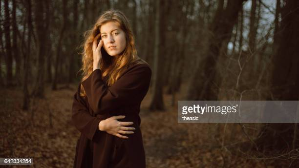 Beautiful young woman in the woods