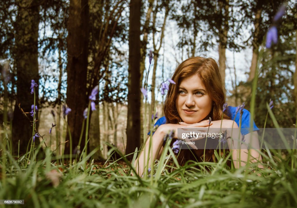 Beautiful young woman in the woods : Foto stock