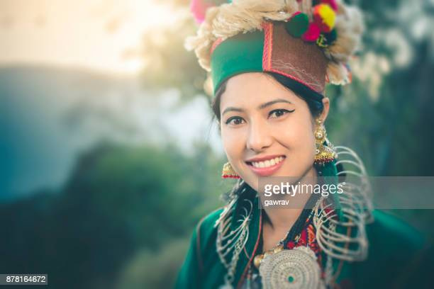 Beautiful young woman in traditional dress of Kinnaur in nature.