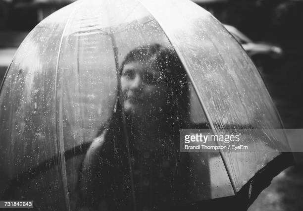 beautiful young woman in wet umbrella during rainy season - rainy season stock pictures, royalty-free photos & images