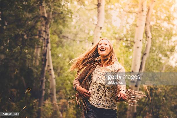Beautiful Young Woman Joyful In Nature Forest Scenery