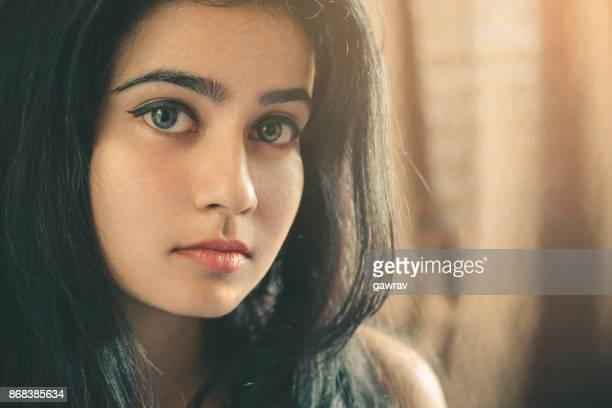 Beautiful young woman looking at camera.