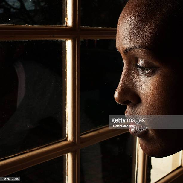 Beautiful young woman looking out .