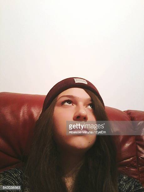 beautiful young woman looking up at home - botoșani romania stock pictures, royalty-free photos & images