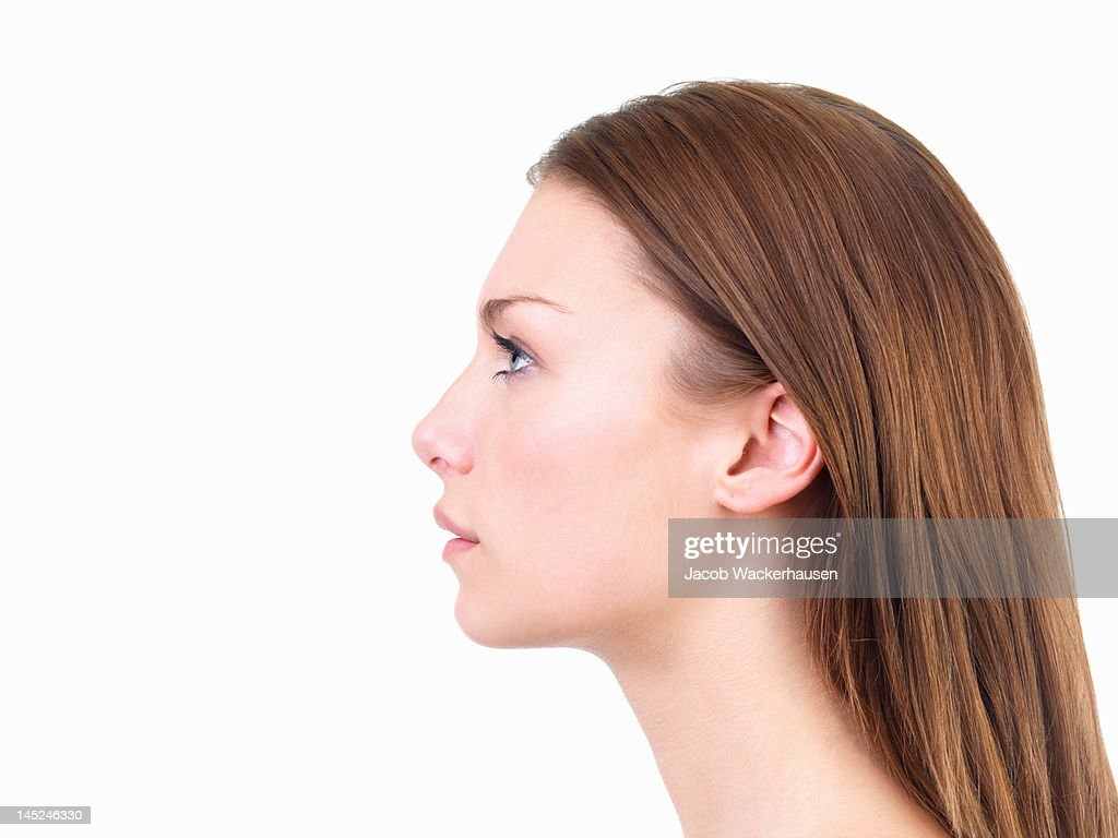 Beautiful young woman looking up : Stock Photo