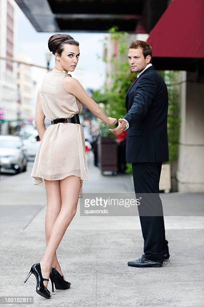 Attractive, Fashionable Young Couple Walking on Downtown Sidewalk