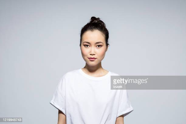beautiful young woman on grey background - mongolian models stock pictures, royalty-free photos & images