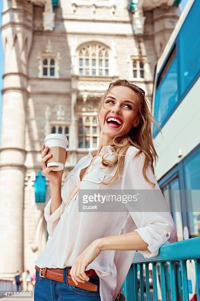 Beautiful young woman on Tower Bridge in London