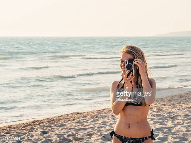 Beautiful Young Woman Photographing On The Beach