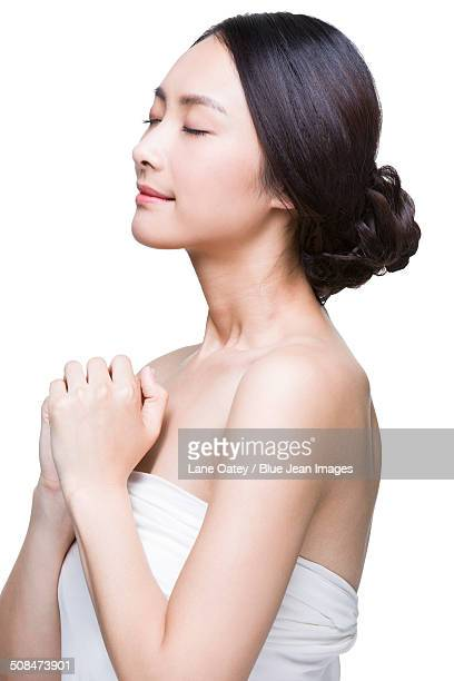 beautiful young woman - wishful skin stock pictures, royalty-free photos & images