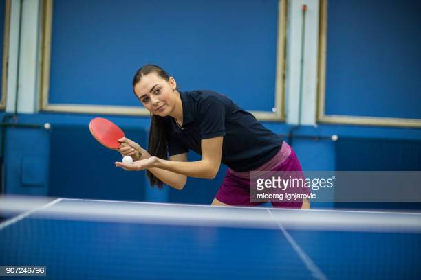 beautiful young woman playing table tennis - table tennis stock pictures, royalty-free photos & images
