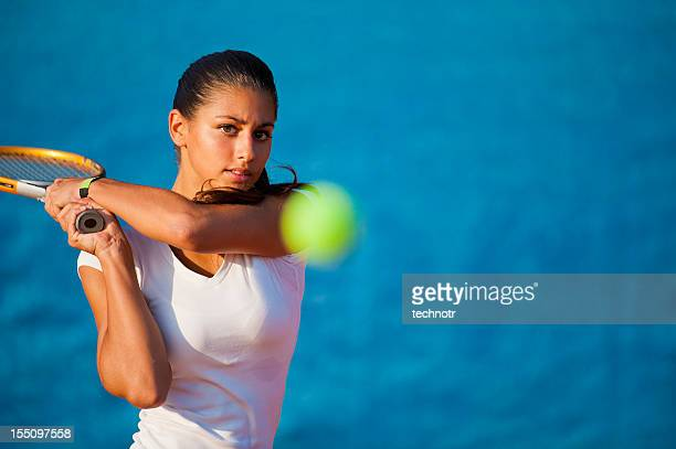 beautiful young woman playing tennis - tennis stock pictures, royalty-free photos & images