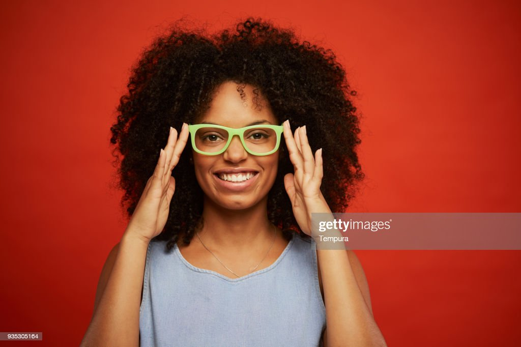 Beautiful young woman portrait playing with hipster glasses. : Foto de stock