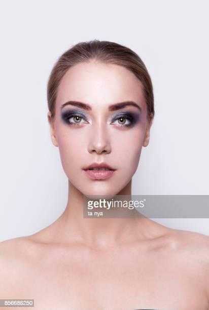 Beautiful young woman portrait Professional make-up Smokey eyes