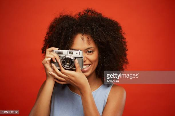 beautiful young woman portrait with retro film camera. - photographic film camera stock photos and pictures