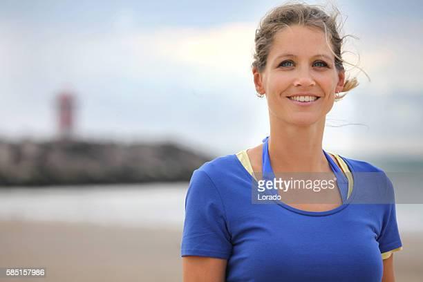 Beautiful young woman posing for beach photo in Summer